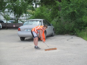 cleaning up the parking lot at MCC Thrift Store