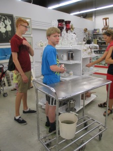 organizing and shelving items at the MCC Thrift Store